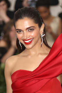 Deepika Padukonbe in Stunning Backless Red Gown High Leg Split At The Metropolitan Museum of Arts Costume Insute Benefit Gala