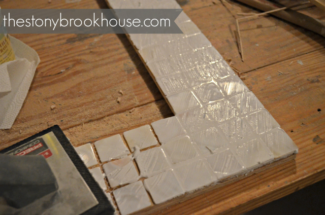 Grouting tiles on mirror frame