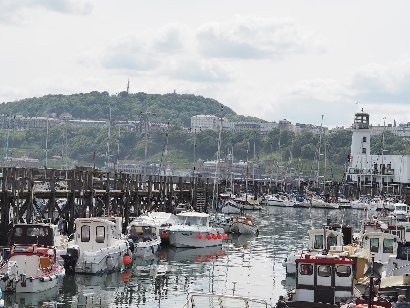 Boats and lighthouse Harbour, South Bay, Scarborough, Yorkshire
