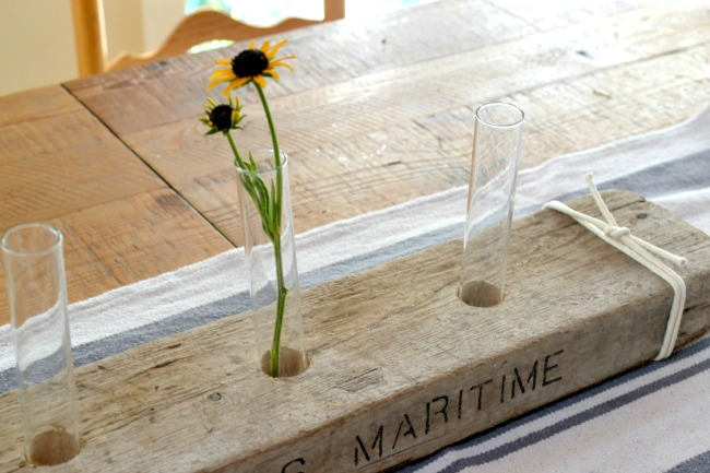 test tubes and flowers in driftwood centerpiece