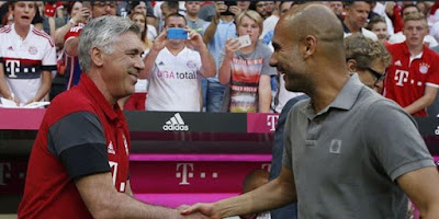 Carlo Ancelotti and pep Guardiola shaking hands
