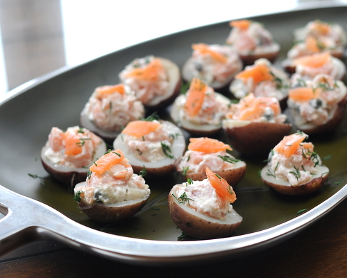 Potato Bites with Smoked Salmon ♥ KitchenParade.com, an easy appetizer with an elegant appearance, tiny potato halves stuffed with smoked salmon in a sour cream & horseradish sauce.