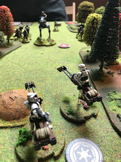 Imperial Speederbikes fire at the Rebel AT-RT
