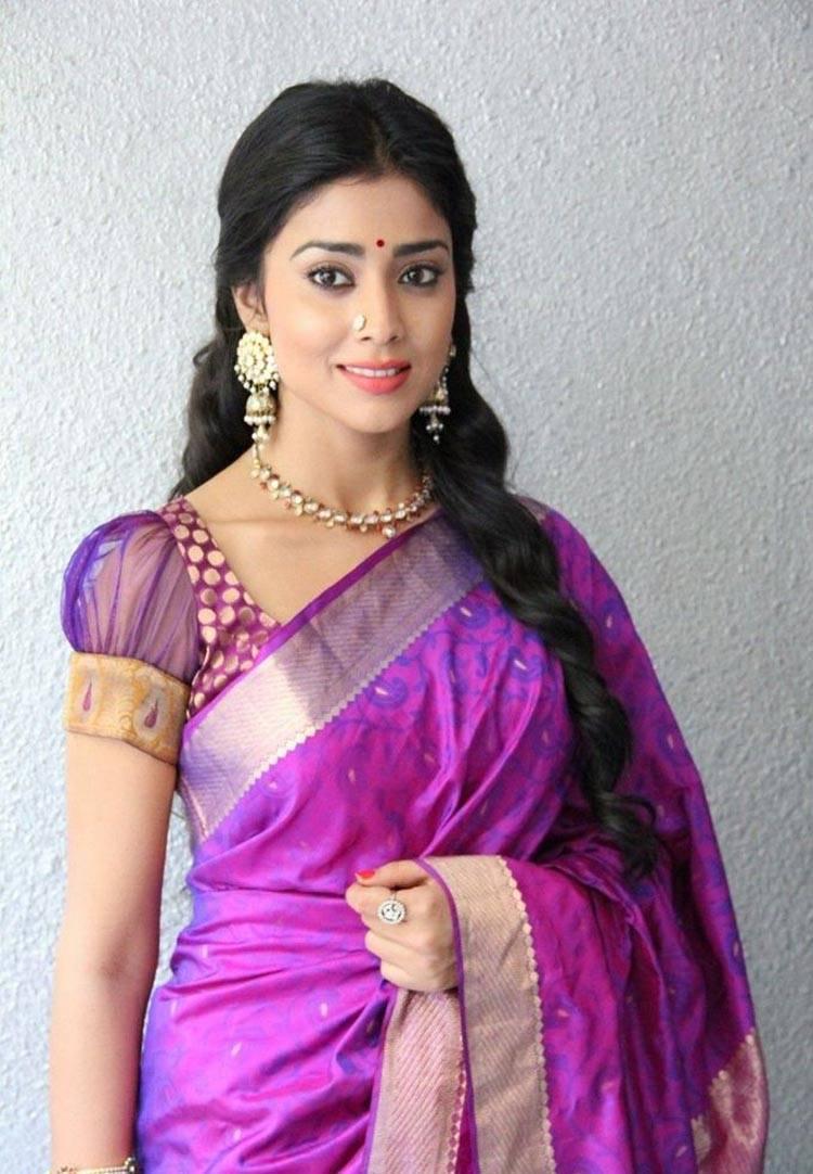 Shriya Saran Stills In Violet Dress