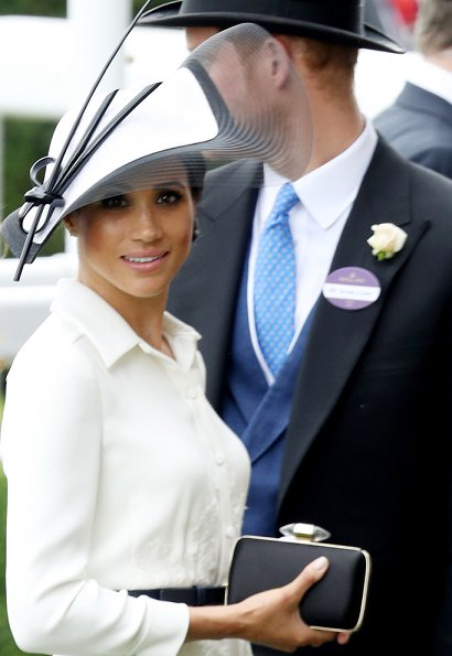 Duchess Meghan Markle wore a bespoke white shirt-style dress by Givenchy and carried a black handbag by the same brand Givenchy