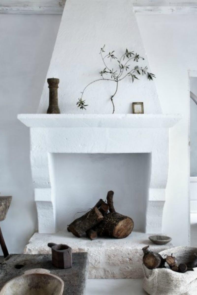 White plaster and stone fireplace in Italian farmhouse - found on Hello Lovely Studio