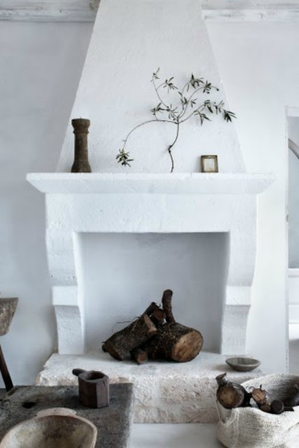 White plaster and stone fireplace in Italian farmhouse - found on Hello Lovely Studio
