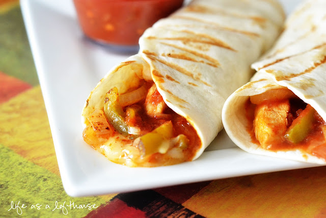 Chicken Fajita Wraps are chicken, onion and peppers marinated in a flavorful marinade wrapped with a flour tortilla. Life-in-the-Lofthouse.com