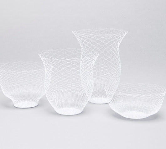 four collapsible white paper vases