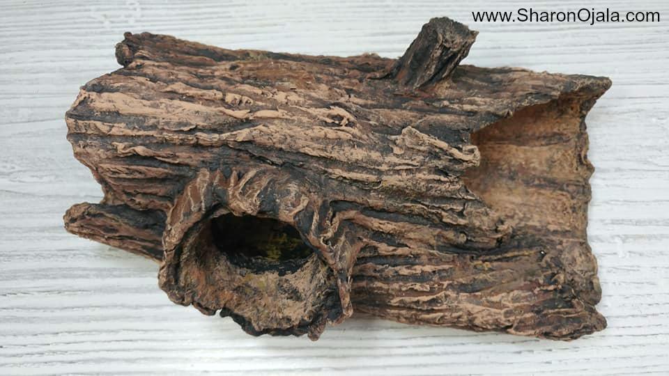 homemade hollow log with fake bark
