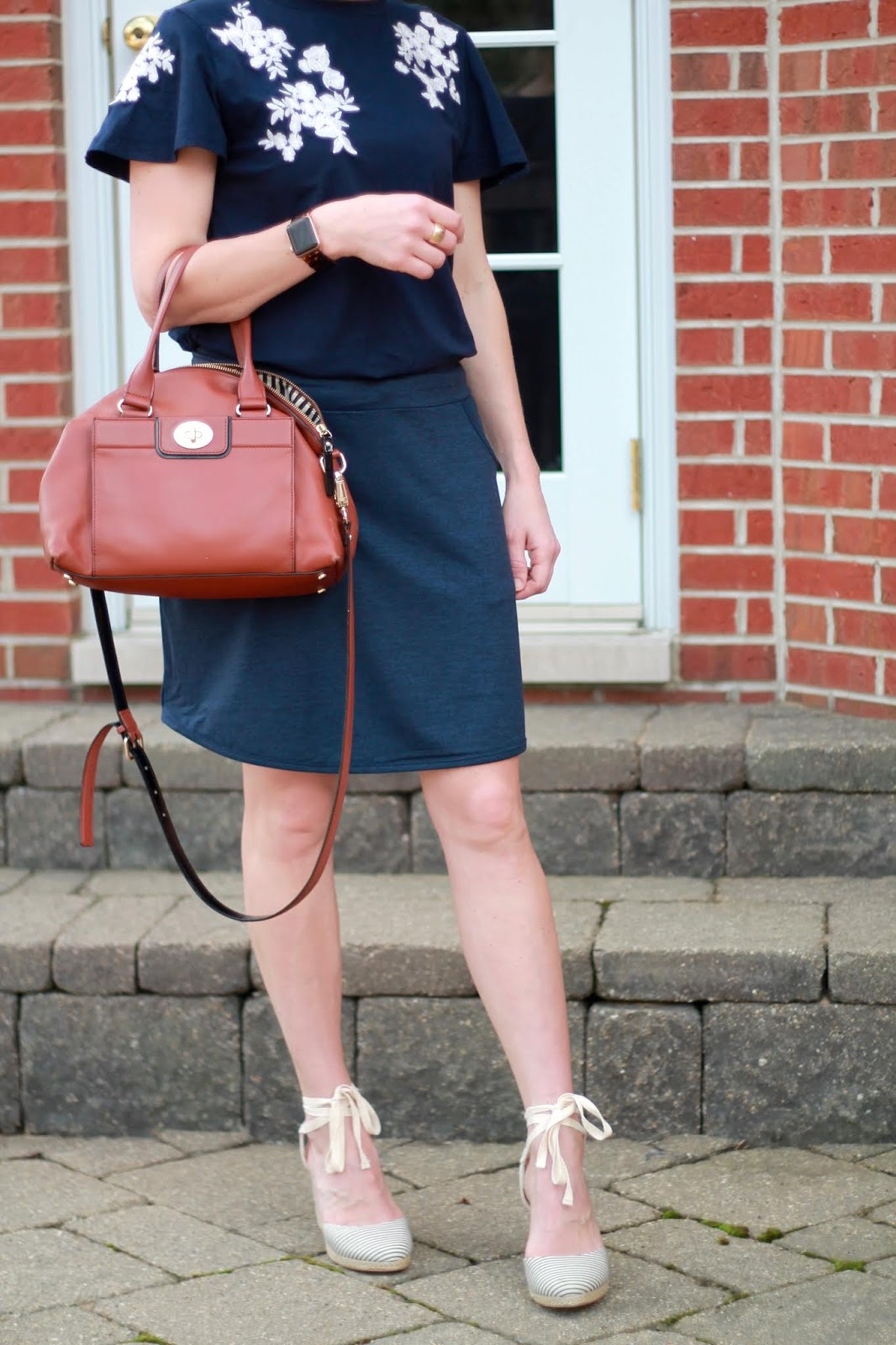 Aventura navy skirt, navy embroidered top, striped espadrilles, cognac crossbody satchel, neon pink earrings