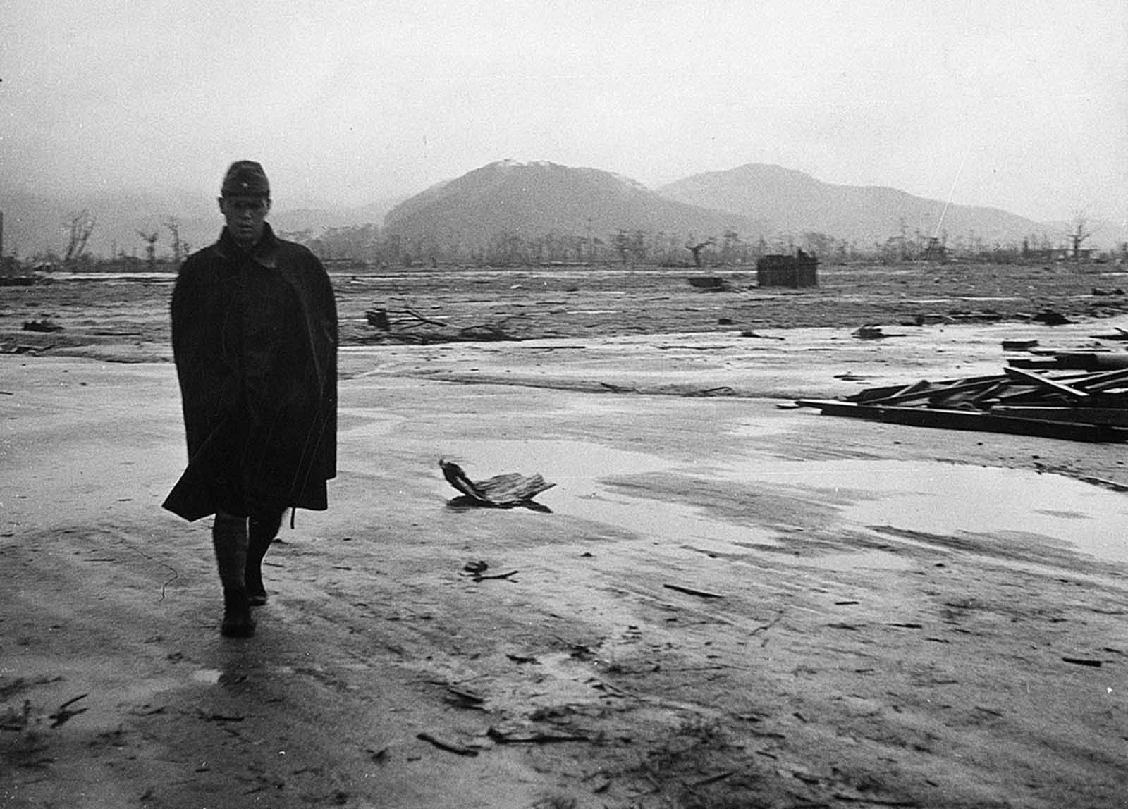 A Japanese soldier walks through a completely leveled area of Hiroshima in September 1945.