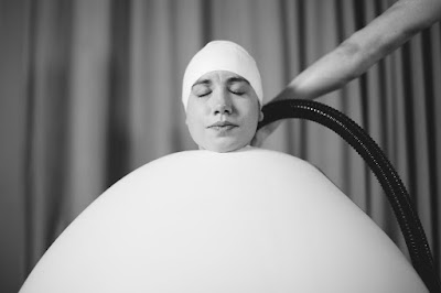 "A balloon costume from the play ""Staging Wittgenstein"" being filled with air"