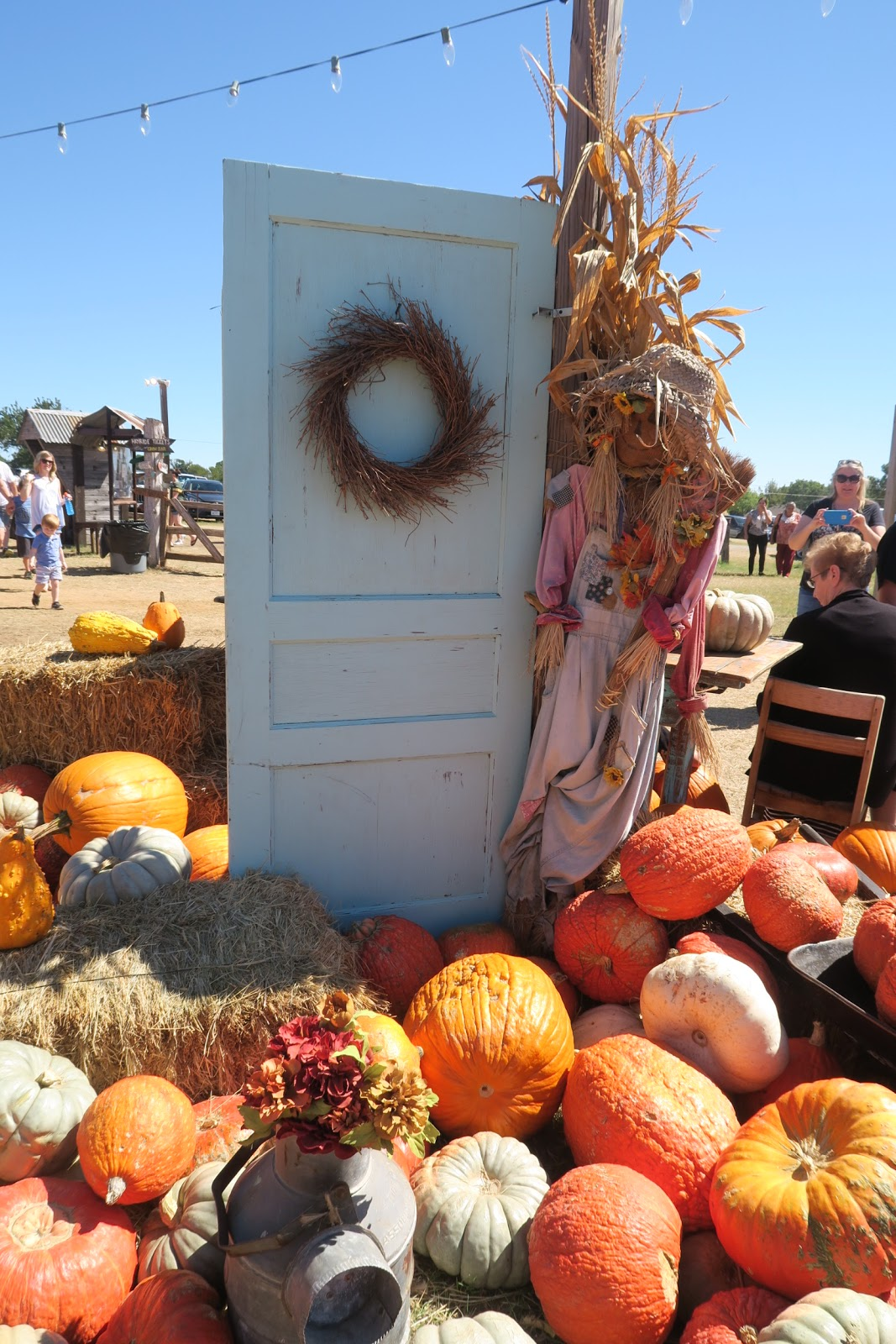 Image: Door surrounded by pumpkins at Hall's pumpkin patch. Blog post about family traditions and family dates.