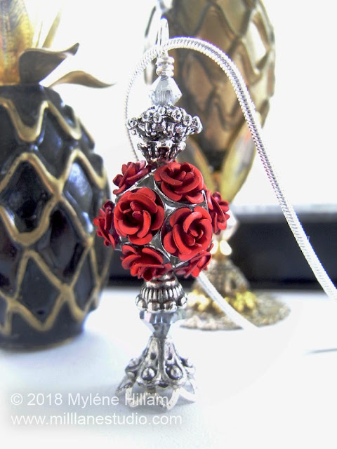 Rose bottle pendant featuring a red rose cluster bead, bead caps and silver Swarovski crystals