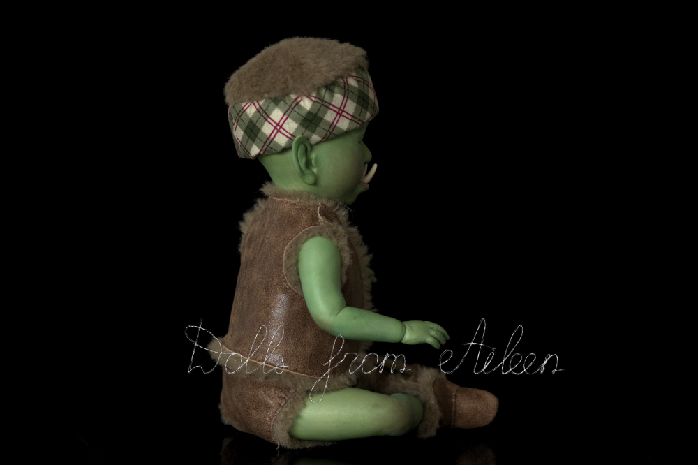 ooak artist baby orc doll, view from side