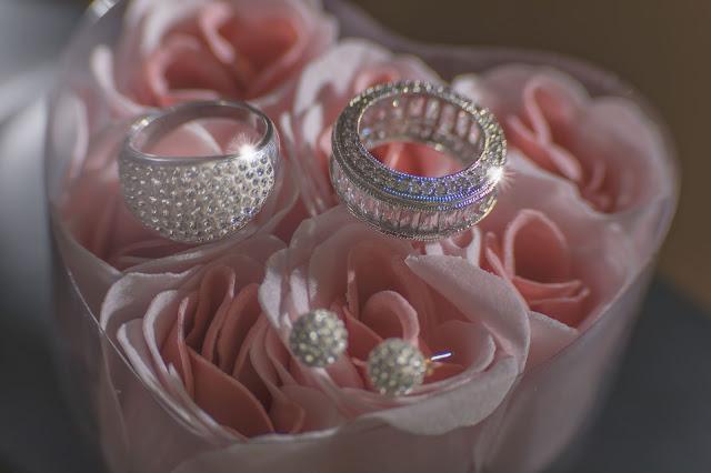 Wedding rings on pink flowers