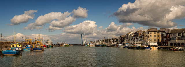 Photo of fluffy white clouds over Maryport Harbour on Easter Sunday