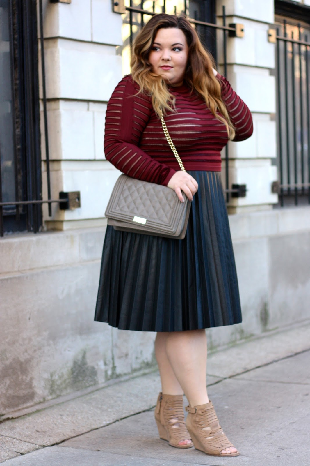 pleated leather midi skirt, pleated skirt, plus size leather skirt, plus size fashion, ps fashion blogger, fashion blogger, natalie craig, natalie in the city, BBW, thick girl, see-through top, balmain top, dulce vita wedges,