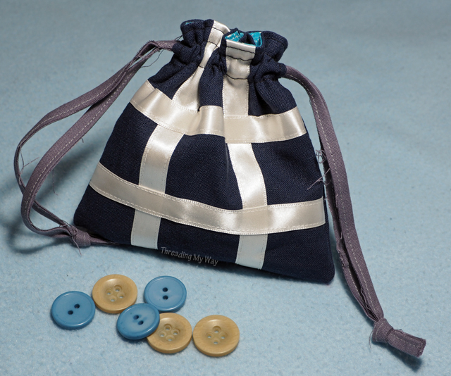 Make a travel tic tac toe game with a simple drawstring bag. Also known as naughts and crosses. Threading My Way