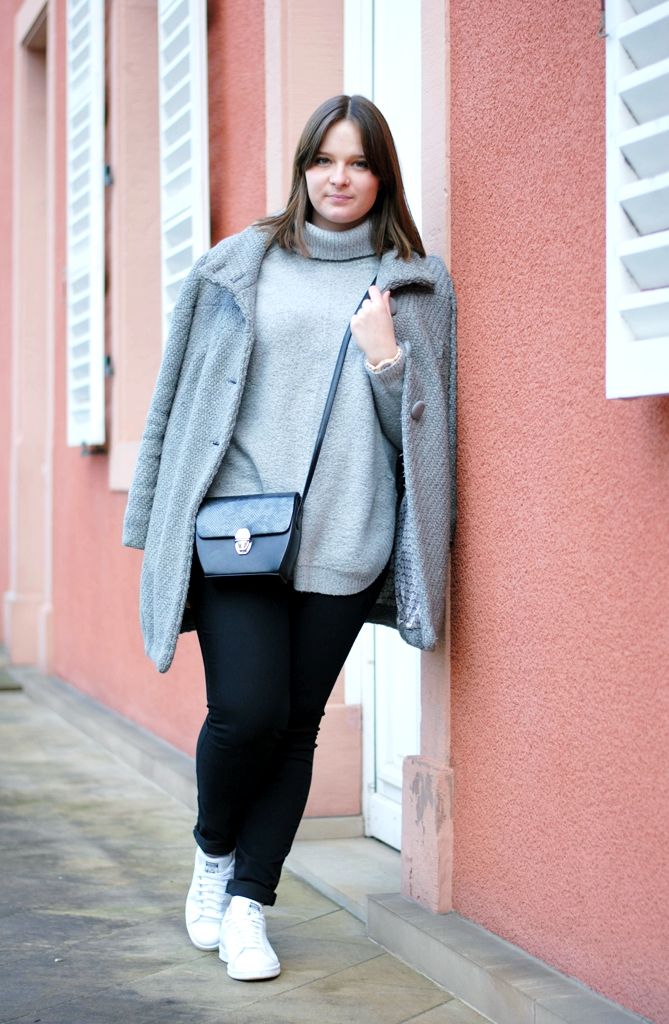 coat slinging and crossbody bag