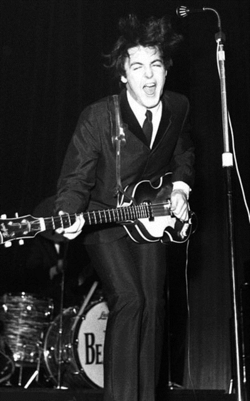 Paul McCartney Rocking Out With His Hofner Bass At An Early Beatles Concert