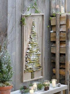 Albero di natale con legnetti muschiati