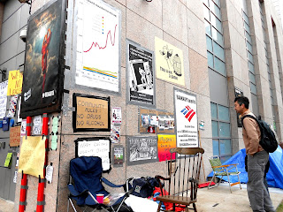 Signs and posters at Occupy Boston By GorillaWarfare (Own work) [CC0], via Wikimedia Commons
