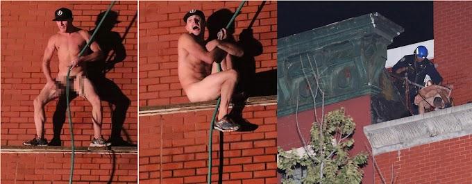 Un desquiciado se desnuda, sube al techo de una escuela y enfrenta la policía con  agua en Greenwich Village