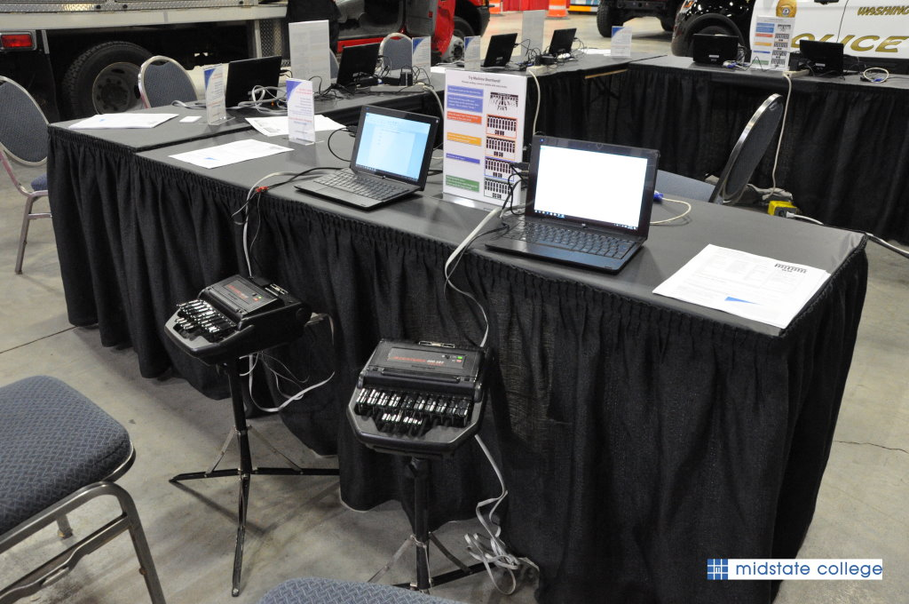 steno machines and laptops at a table