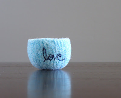small felted bowl with the word love