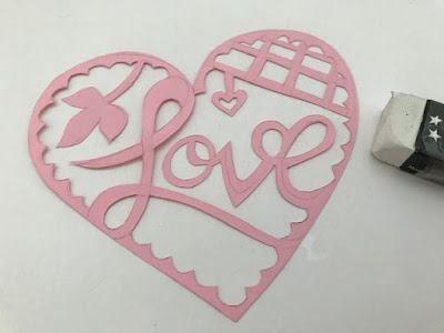 Papercutting and erasing the pencil marks