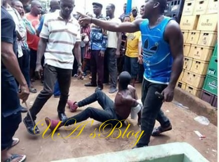 Kidnapper Caught With 2 Children In Imo, Beaten Mercilessly By Vigilante (Photos)