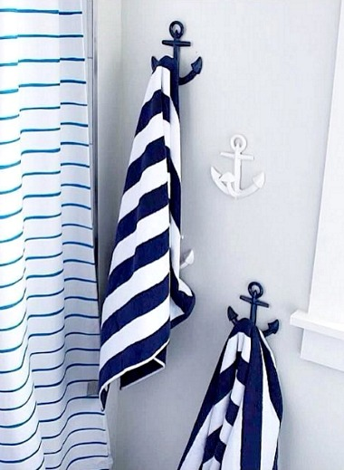 Blue and White Anchor Hooks in Bathroom