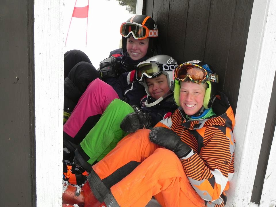 Three skiers sitting