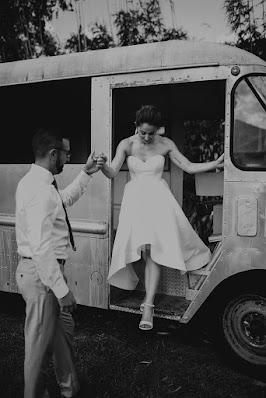 bride stepping out of vintage hipster van
