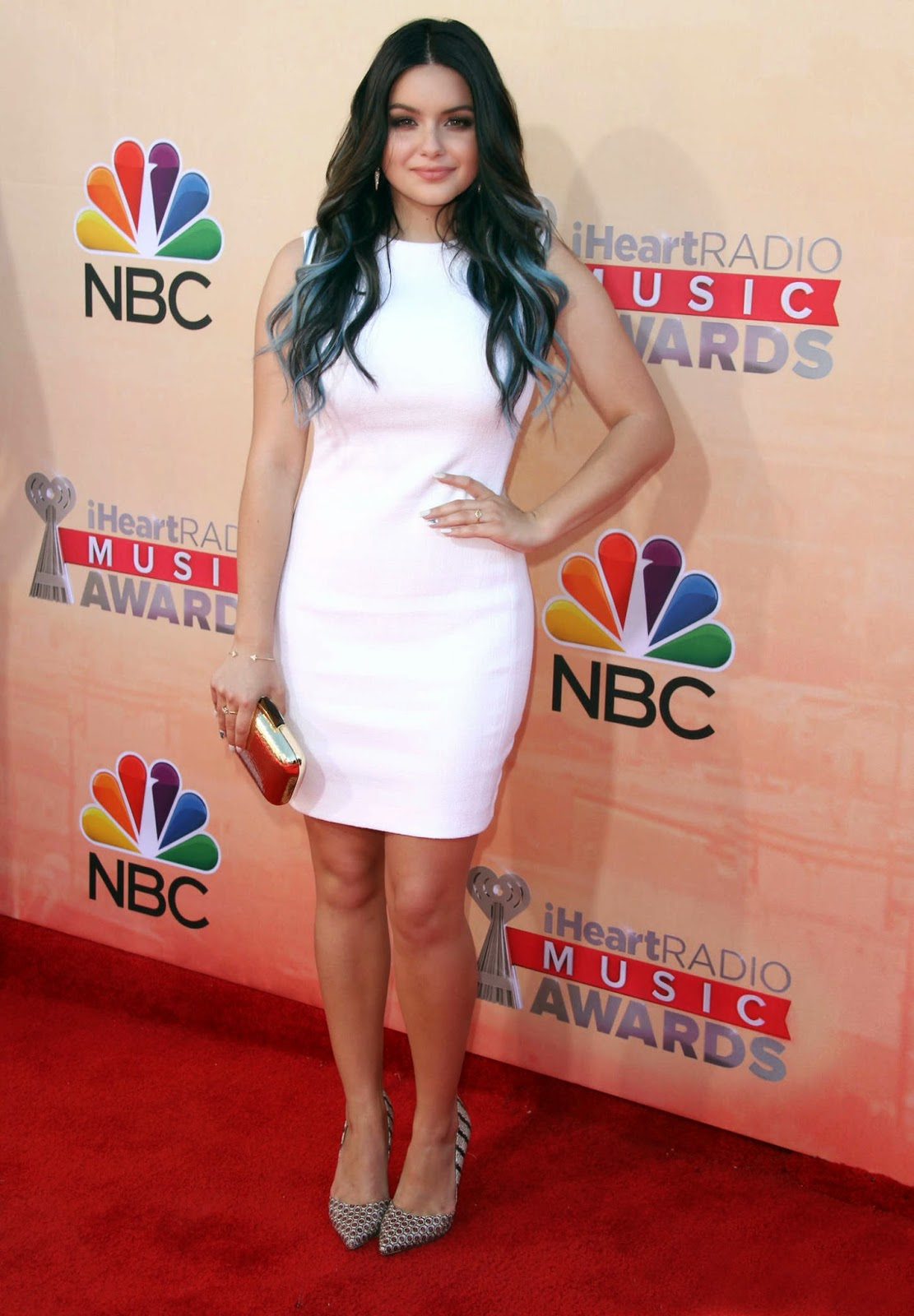 Ariel Winter in a figure hugging white dress at the 2015 iHeart Radio Music Awards in LA