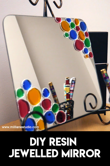 Square mirror decorated with colourful resin circles in a plate stand
