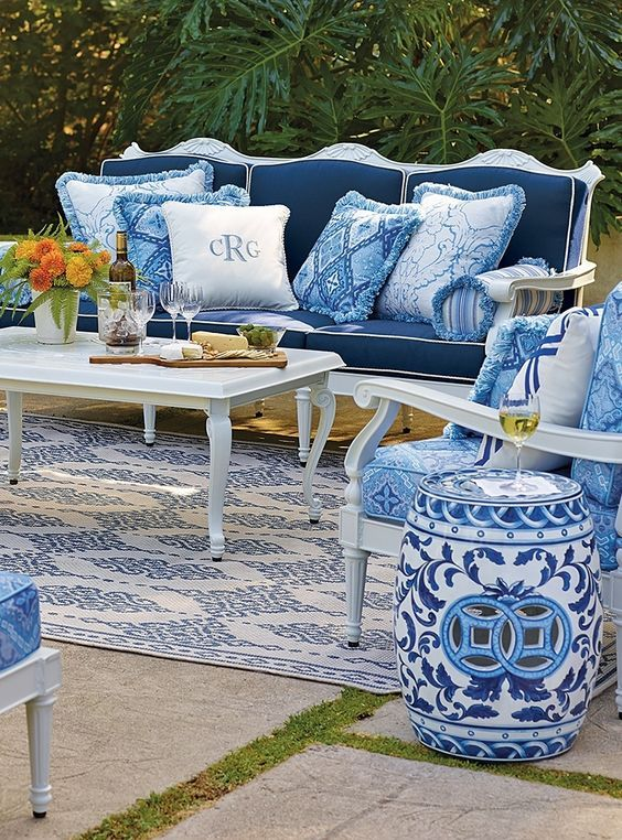 Gorgeous blue and white decorated patio furniture with Chinoiserie garden stool - found on Hello Lovely Studio