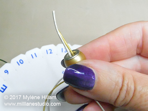 Threading leather cords through a large hole bead