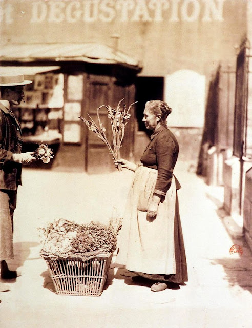 Middle age women sells flowers on the street corner in Paris 1899
