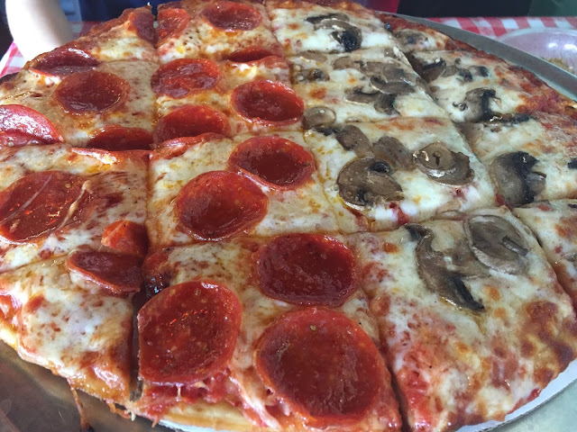 Delicious pepperoni and mushroom pizza at Lola's Pizza Palace in Arlington Heights, Illinois
