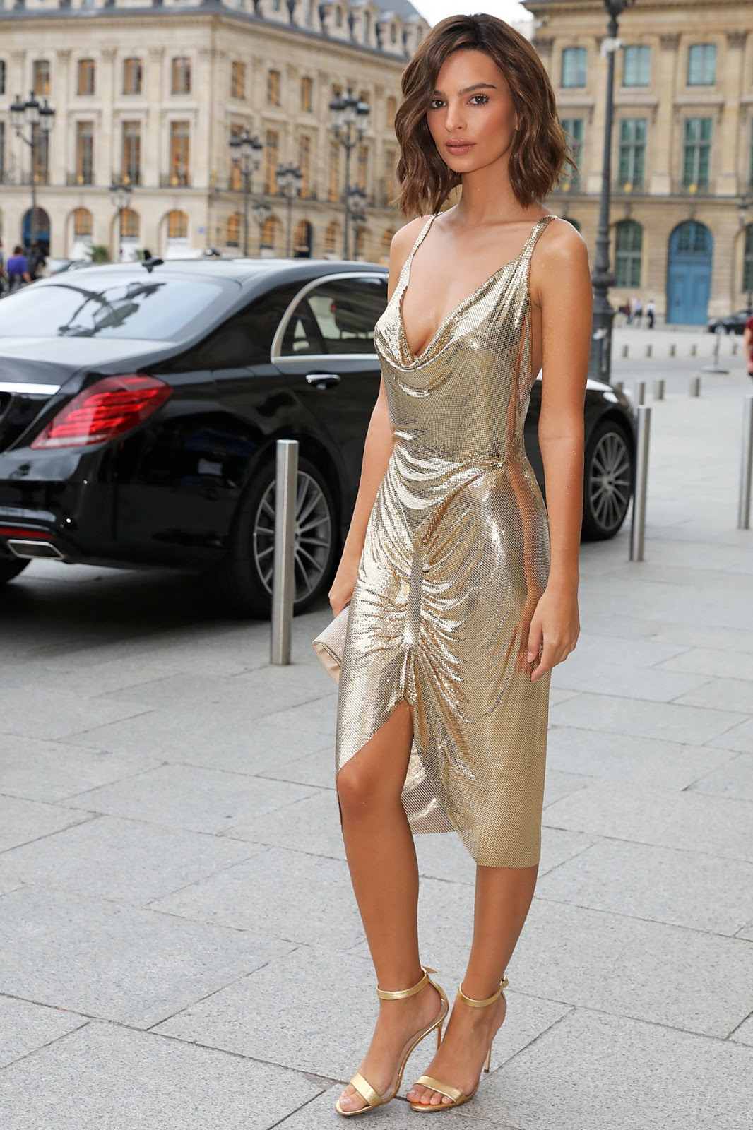 Emily Ratajkowski goes braless in a slinky shimmering cocktail dress as she continues to display her newly-chopped locks during Paris Fashion Week