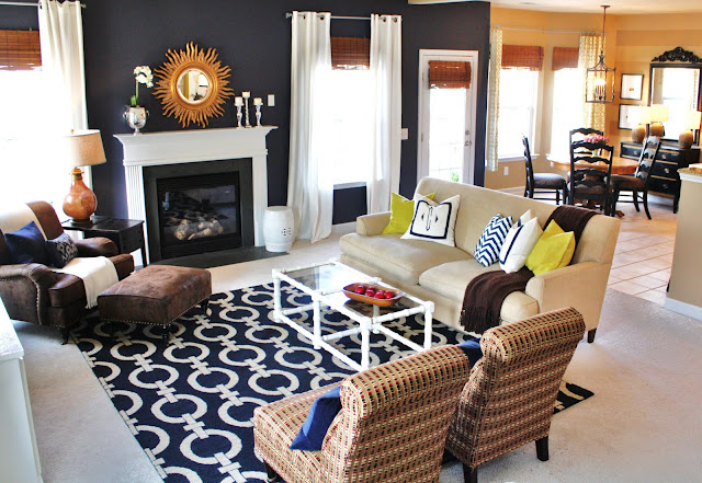 navy living room with tall curtain panels & bamboo shades via emilyaclark.com