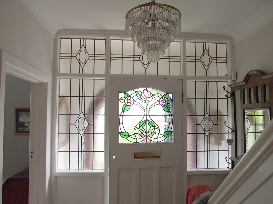 Through the round window 1930s stained glass door panel for Oversized exterior doors for sale