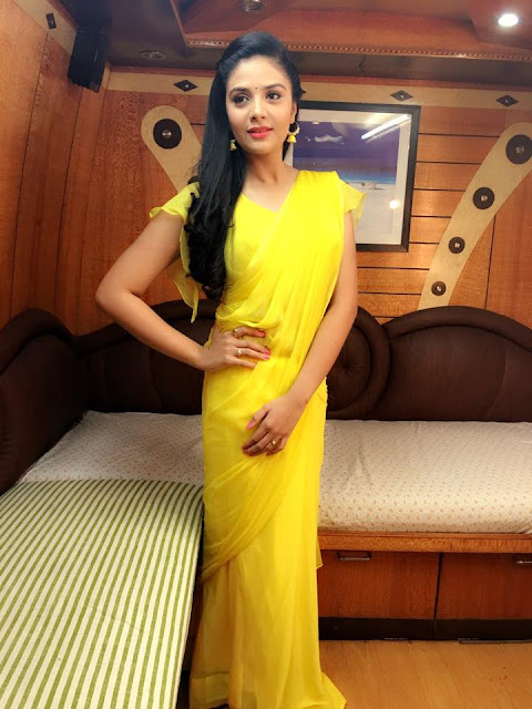 Sreemukhi in Yellow color saree photos