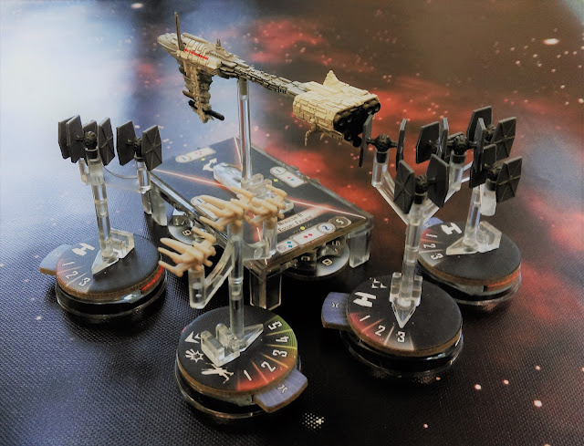 Nebulon-B frigate and escort squadron engaged by Tie fighters