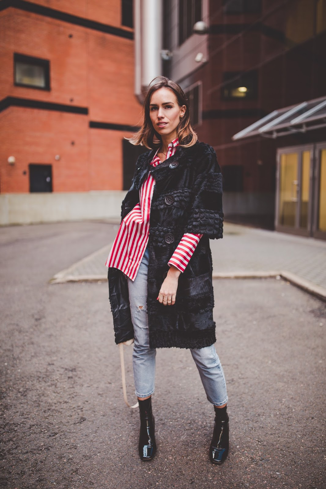 black fur coat jeans fall outfit