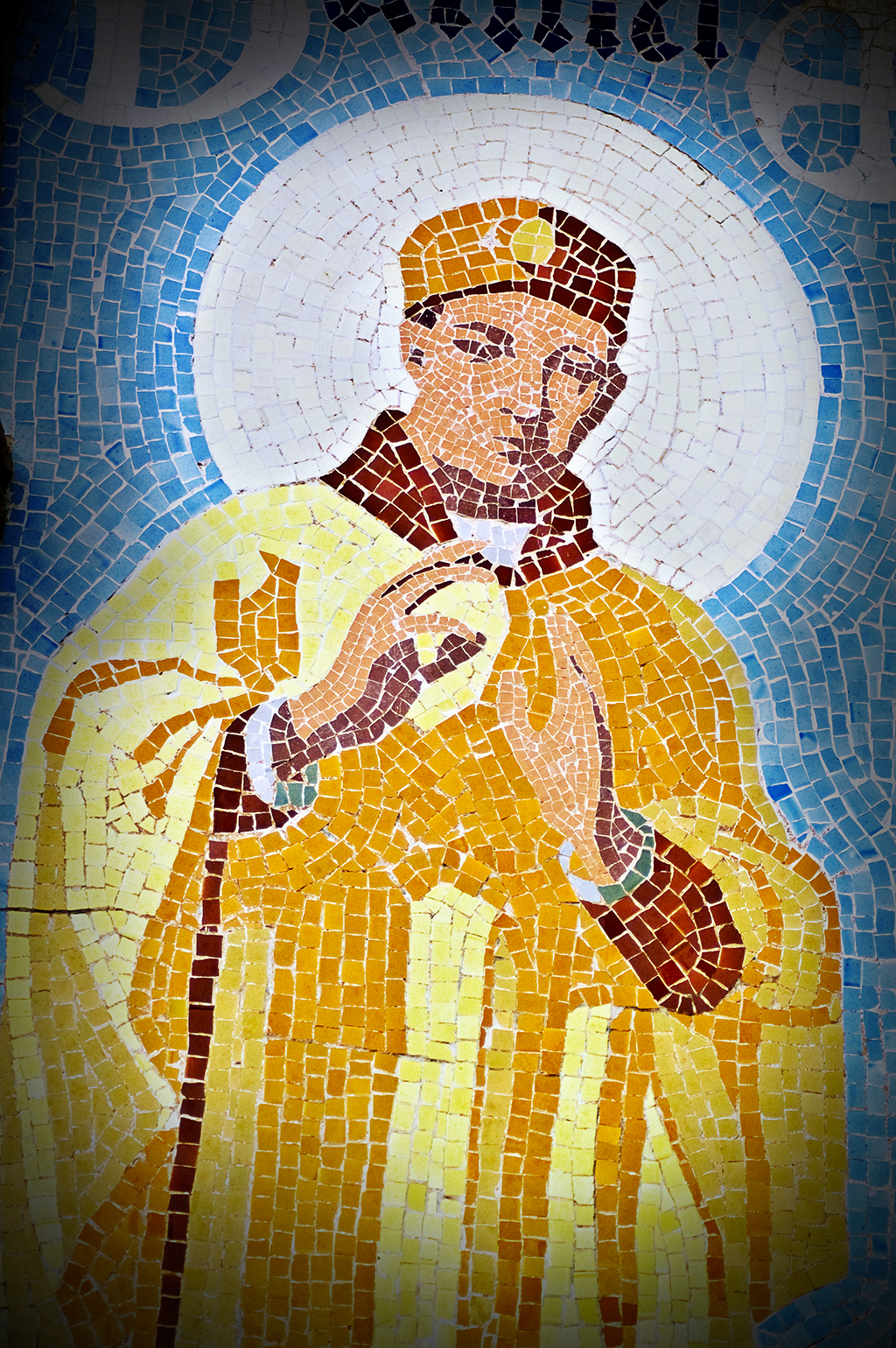 Detail of religious man modernista mosaic at Hospital de Sant Pau, Barcelona