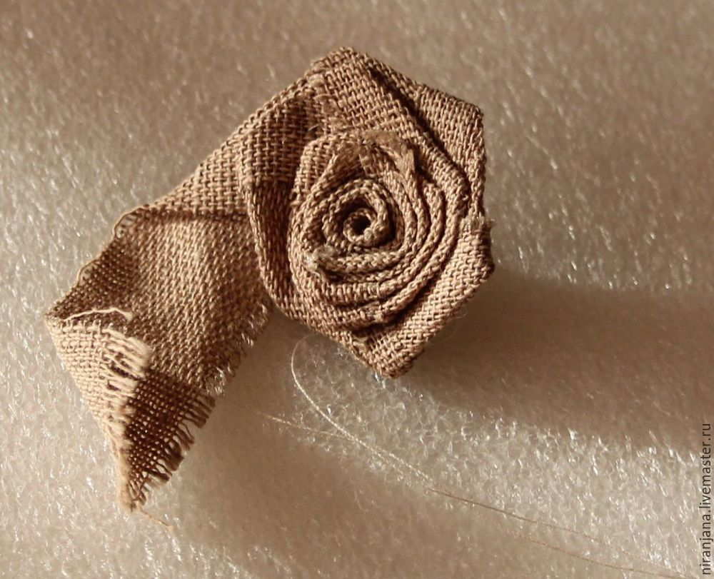 How easy and quick to sew a rose from a fabric or satin ribbon.